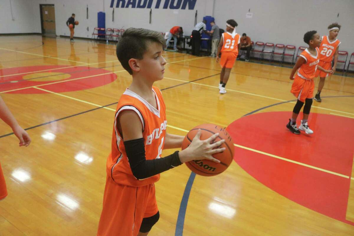La Porte's Mason Hill joins his teammates for a warm-up drill prior to a 7A Silver Division tournament-opening game at Bondy Intermediate School Friday night. With Hill's help, La Porte swept its Friday night twinbill, but lost to San Jacinto Intermediate Saturday afternoon.