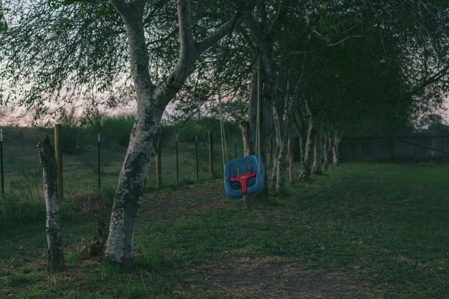 A swing sits in the backyard of Salvador Castillo and Yvette Arroyo's home next to the Rio Grande levee in Brownsville, Texas. Photo: Photo By Brenda Bazán For The Washington Post / For The Washington Post