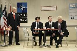 """Alec Baldwin as Donald Trump, Jimmy Fallon as Justin Trudeau, Paul Rudd as Emmanuel Macron, and James Corden as Boris Johnson during the """"Nato Cafeteria"""" Cold Open on Saturday, December 7, 2019 -- (Photo by: Will Heath/NBC/NBCU Photo Bank via Getty Images)"""