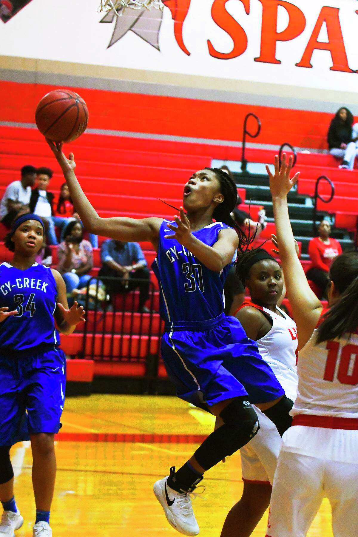 Cy-Creek (30) Kyndall Hunter made some acrobatic fast break moves to the basketball to help her team defeat Cy-Lakes and win the Cypress District Championship.