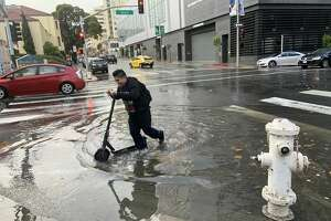 A large puddle of rainfall accumulated on Franklin Street in San Francisco on Dec. 7, 2019.