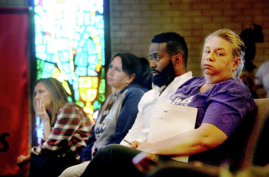 Lanay Hebert, who lives on Pine Street within a mile of the plant, reacts as she listens to information offered in regards to TPC Group's explosion and its impact to the environnment, surrounding communities and residents during a town hall meeting hosted by Lone Star Legal Aid at Empowerment Church in Port Arthur Saturday.