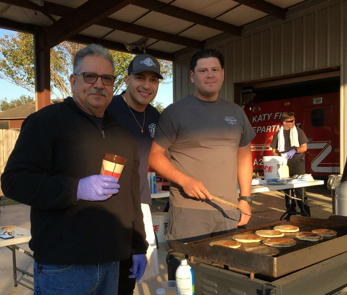 Katy Professional Firefighters Local 5192 opened the doors at Station 1 early Saturday, Dec. 7, for its second annual Pancakes with Santa. From left are Victor Vaesa, a part-time firefighter with the Willowfork Fire Department; Christopher Gonzales, a Katy firefighter/EMT, and Omar Cepeda, Katy firefighter/paramedic/pancake maker.