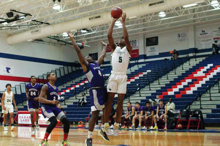 Clear Falls' Corey Kelly (5) muscles up a shot over Houston Northside's Jaylon Travis (4) in the Carlisle-Krueger Classic at Clear Lake High School. Photo: Kirk Sides / Staff Photographer / © 2019 Kirk Sides / Houston Chronicle