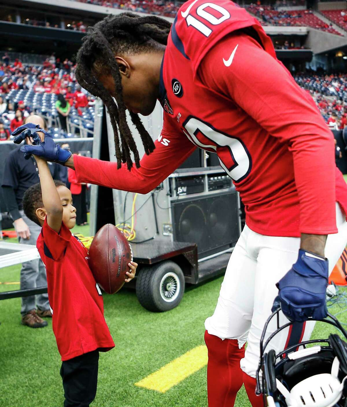 Houston Texans wide receiver DeAndre Hopkins (10) greets Daylon Watkins, 7, before an NFL football game against the Denver Broncos at NRG Stadium on Sunday, Dec. 8, 2019, in Houston. Watkins comes to the game through the Make-A-Wish Foundation. Watkins has been diagnosed with Severe Aplastic Anemia and has spent the past couple days visiting the the Texans player during practice and Sunday's game.