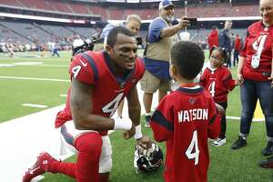 Houston Texans fan Daylon Watkins, 7, talks with Texans quarterback Deshaun Watson before an NFL football game against the Denver Broncos at NRG Stadium on Sunday, Dec. 8, 2019, in Houston. Watkins comes to the game through the Make-A-Wish Foundation. Watkins has been diagnosed with Severe Aplastic Anemia and has spent the past couple days visiting with Texans quarterback Deshaun Watson and the rest of the Texans.