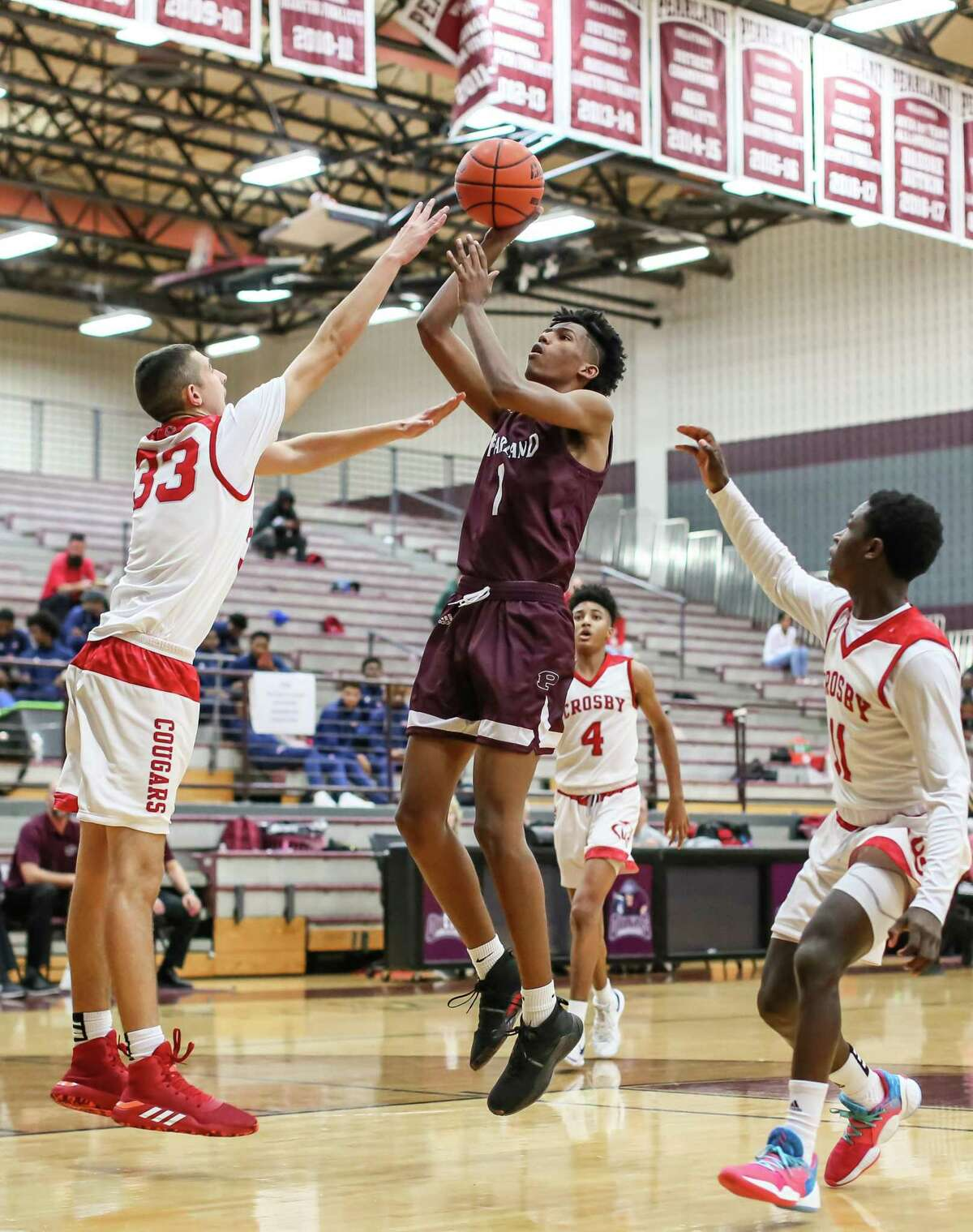 Pearland post Robel Desta drives to the basket against Crosby in the Pearland ISD Basketball Classic.