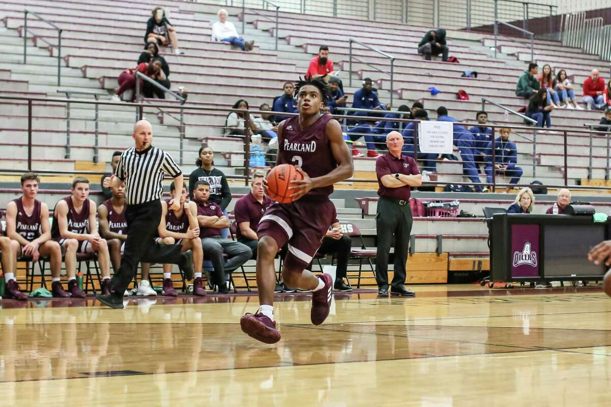 Pearland senior guard A.J. Tyler makes a move to the basket in a Pearland ISD Basketball Classic game against Crosby.