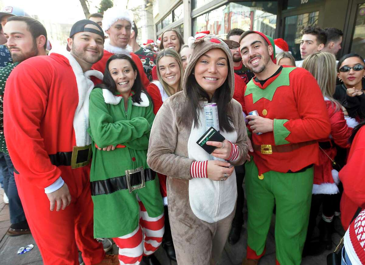 A parade of festiveness Santa's, Merry Elf's, Reindeer line up in front of Jimmy's BBQ as several hundred Jolly souls participate in the Annual Stamford SantaCon Holiday Crawl on Dec. 7, 2019 in Stamford, Connecticut.