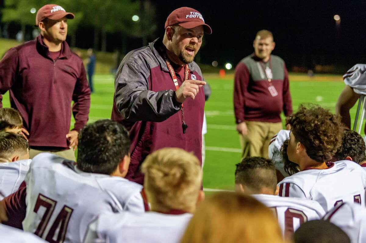 Silsbee coach Randy Smith speaks to his team following the Tigers' win over West Orange-Stark on Friday night in the Class 4A-II regional final. Fran Ruchalski/The Enterprise