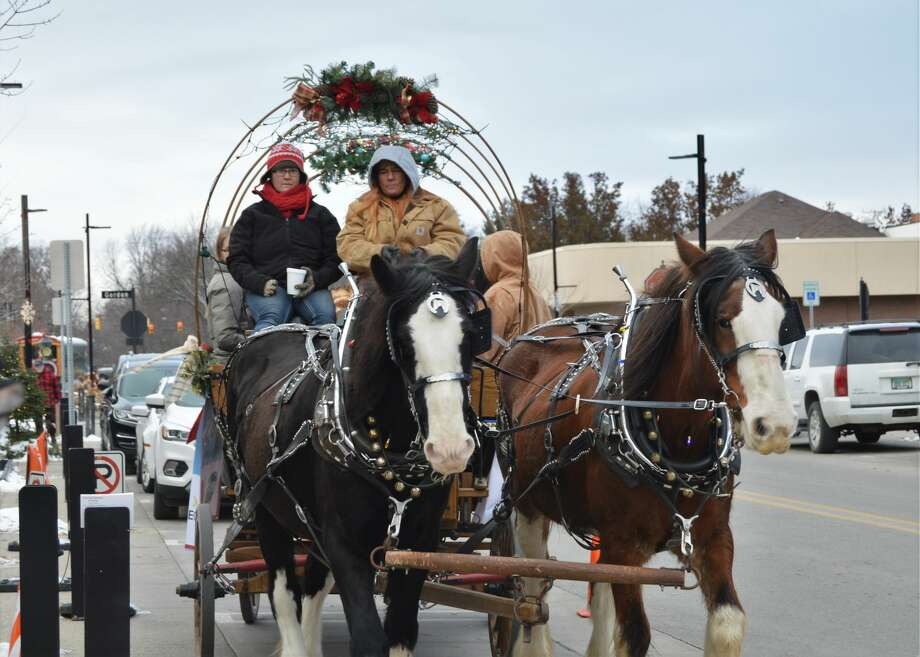 Holly Jolly Days took place this weekend in downtown Midland, offering the community free carriage rides, train rides, hot cocoa, Santa House visits, a TubaChristmas concert, and more. The event continues Dec. 14 and 15 as well. (Ashley Schafer/Ashley.Schafer@hearstnp.com) Photo: Ashley Schafer