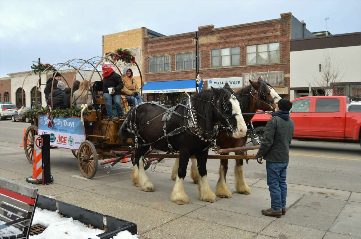 Holly Jolly Days took place this weekend in downtown Midland, offering the community free carriage rides, train rides, hot cocoa, Santa House visits, a TubaChristmas concert, and more. The event continues Dec. 14 and 15 as well. (Ashley Schafer/Ashley.Schafer@hearstnp.com)