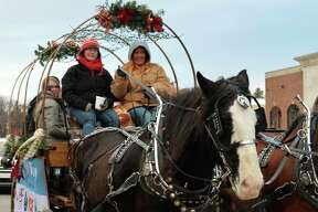 Holly Jolly Days took place this weekend in downtown Midland, offering the community free carriage rides, train rides, hot cocoa, Santa House visits, a Tubachristmas concert, and more. (Ashley Schafer/Ashley.Schafer@hearstnp.com)