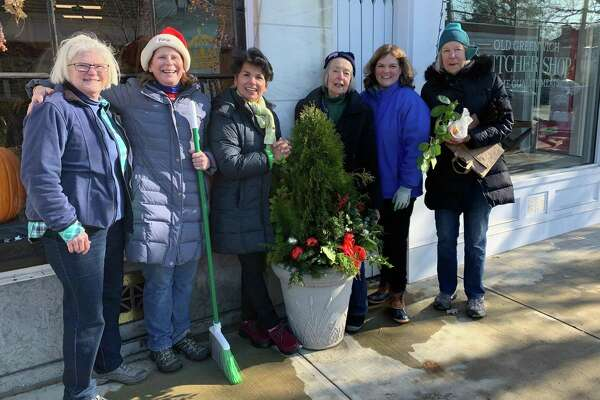 Members of the Garden Club of Old Greenwich get in a festive mood along Sound Beach Avenue. Volunteers braved the cold to put up decorations they put together on both sides of the street. From left, Betsie Harkins, Betsy Kreuter, Monica Meskers, Lorese McQuinn, Wendy Yu and Ros Brady.