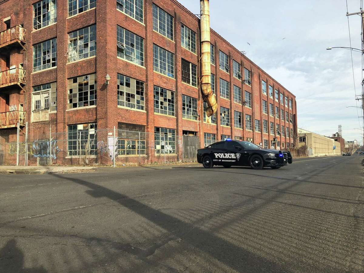 Barnum Avenue was blocked between Helen Street and Seaview Avenue as police investigated the discovery of a body near the former Remington Arms factory Dec. 8, 2019.