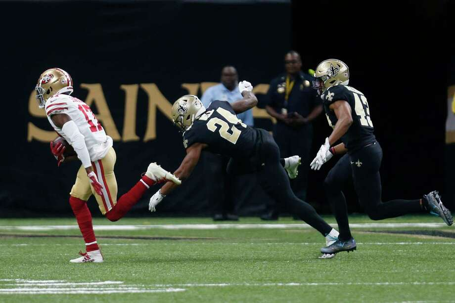 San Francisco 49ers wide receiver Emmanuel Sanders (17) carries on a touchdown reception as New Orleans Saints free safety Marcus Williams (43) and defensive back K'Waun Williams (24) pursue in the first half an NFL football game in New Orleans, Sunday, Dec. 8, 2019. Photo: Butch Dill, AP / Copyright 2019 The Associated Press. All rights reserved.