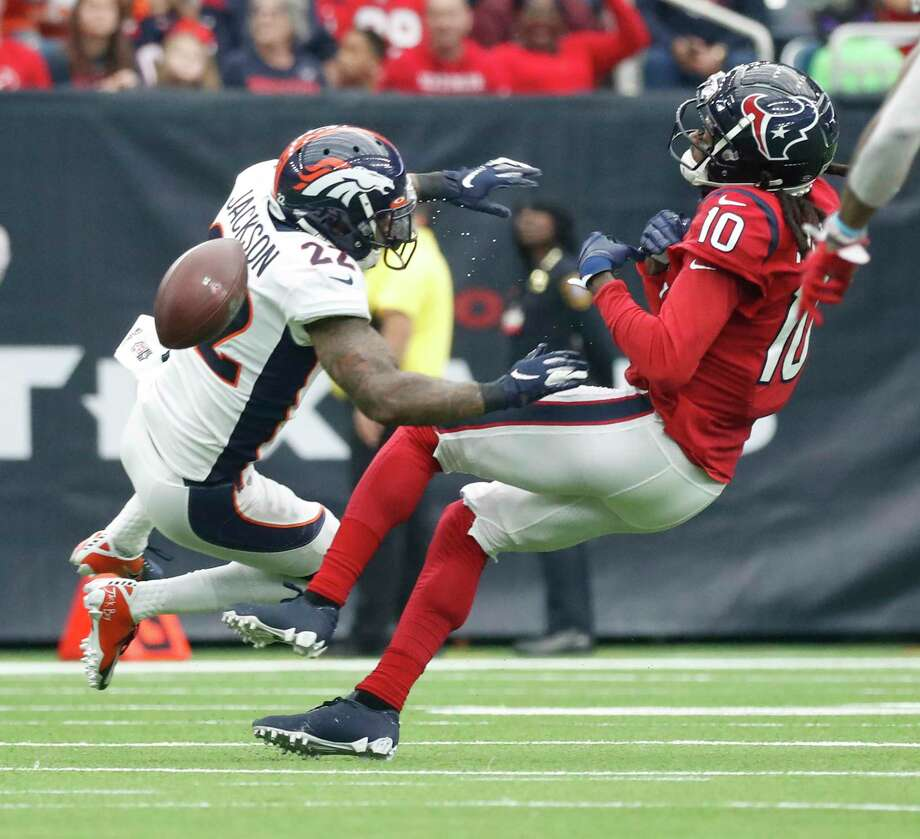 Houston Texans wide receiver DeAndre Hopkins (10) is hit hard by Denver Broncos strong safety Kareem Jackson (22) as he went up for a pass during the first half of an NFL football game at NRG Stadium, Sunday, Dec. 8, 2019, in Houston. Photo: Karen Warren, Staff Photographer / © 2019 Houston Chronicle