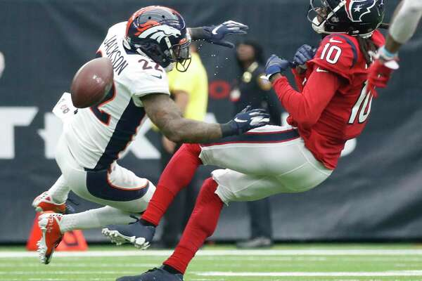 Houston Texans wide receiver DeAndre Hopkins (10) is hit hard by Denver Broncos strong safety Kareem Jackson (22) as he went up for a pass during the first half of an NFL football game at NRG Stadium, Sunday, Dec. 8, 2019, in Houston.