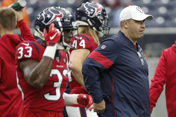 Houston Texans head coach Bill O'Brien walks on the field with his team before the Texans game against the Denver Broncos at NRG Stadium on Sunday, Dec. 8, 2019, in Houston.