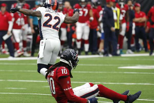 Denver Broncos strong safety Kareem Jackson (22) celebrates after breaking up a pass intended for Houston Texans wide receiver DeAndre Hopkins (10) during the first quarter of an NFL football game at NRG Stadium on Sunday, Dec. 8, 2019, in Houston.