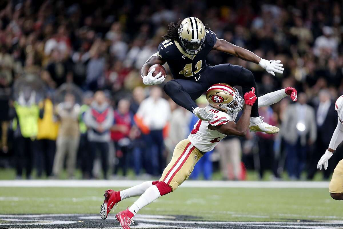 New Orleans Saints running back Alvin Kamara (41) hurdles over San Francisco 49ers free safety Jimmie Ward (20) in the first half an NFL football game in New Orleans, Sunday, Dec. 8, 2019. (AP Photo/Brett Duke)