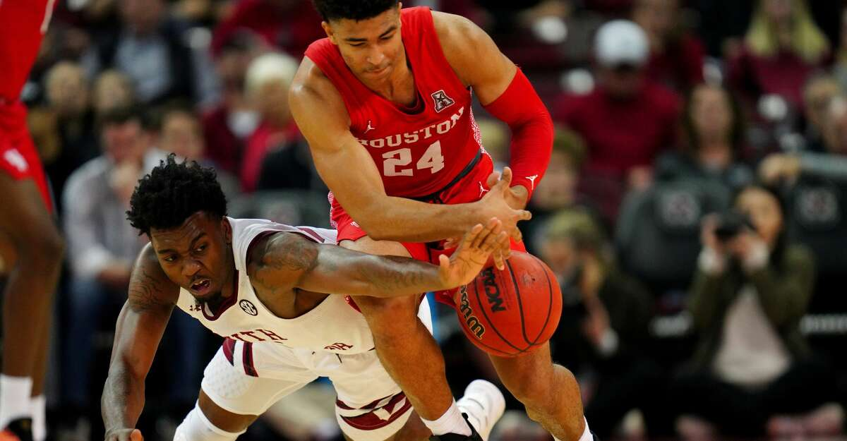 COLUMBIA, SOUTH CAROLINA - DECEMBER 08: Jermaine Couisnard #5 of the South Carolina Gamecocks and Quentin Grimes #24 of the Houston Cougars fight for the ball during the first half during their game at Colonial Life Arena on December 08, 2019 in Columbia, South Carolina. (Photo by Jacob Kupferman/Getty Images)
