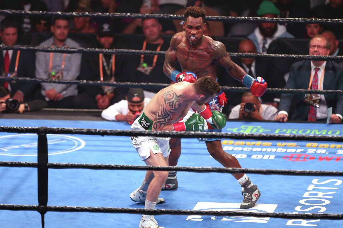 Jermall Charlo (right) delivers punch against contender Dennis Hogan during a boxing match, Saturday, Dec. 7, 2019, in Brooklyn. Charlo defends Middleweight World Championship by seventh round TKO. (AP Photo/Vera Nieuwenhuis)
