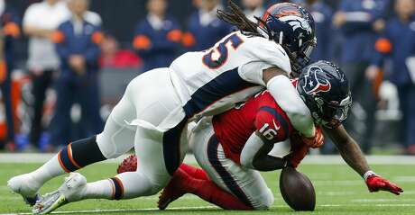 Denver Broncos linebacker A.J. Johnson (45) forces Houston Texans wide receiver Keke Coutee (16) to fumble the ball after a reception during the first quarter of an NFL game at NRG Stadium Sunday, Dec. 8, 2019, in Houston.