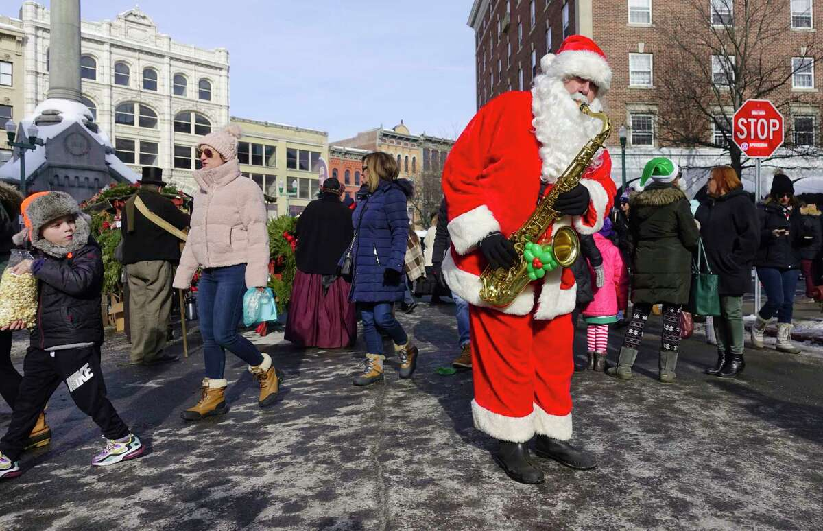 Luke McNamee of Troy, as SaxoClaus, plays music on the street at the 37th Annual Troy Victorian Stroll on Sunday, Dec. 8, 2019, in Troy, N.Y. (Paul Buckowski/Times Union)
