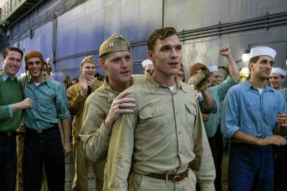 This image released by Lionsgate shows Luke Kleintank, foreground left, and Ed Skrein in a scene from