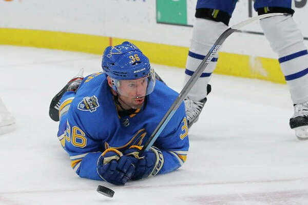 The Blues' Troy Brouwer looks for the puck after falling to the ice during the second period against the Toronto Maple Leafs on Saturday night in St. Louis.
