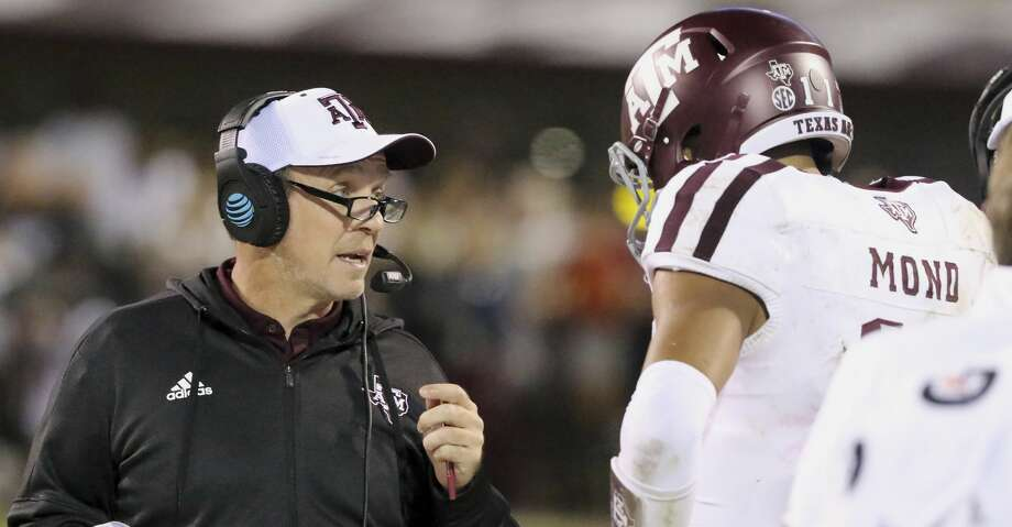 Texas A&M head coach Jimbo Fisher, left, talks to quarterback Kellen Mond (11) during the second half of an NCAA college football game against Mississippi State, Saturday, Oct. 27, 2018, in Starkville, Miss. (AP Photo/Jim Lytle) Photo: Jim Lytle/Associated Press