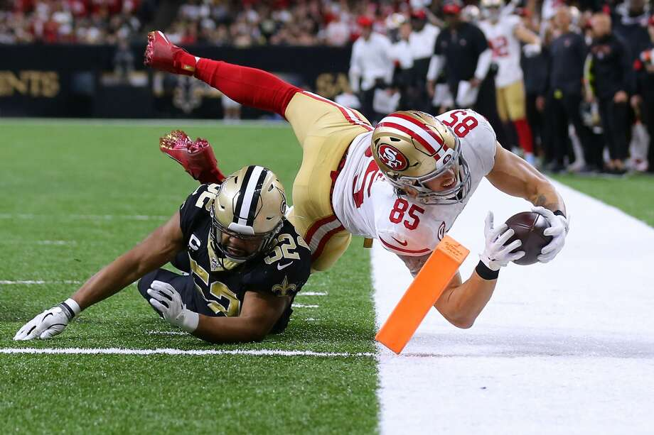 NEW ORLEANS, LOUISIANA - DECEMBER 08: George Kittle #85 of the San Francisco 49ers scores a touchdown as Craig Robertson #52 of the New Orleans Saints defends during the second half of a game at the Mercedes Benz Superdome on December 08, 2019 in New Orleans, Louisiana. (Photo by Jonathan Bachman/Getty Images) Photo: Jonathan Bachman/Getty Images