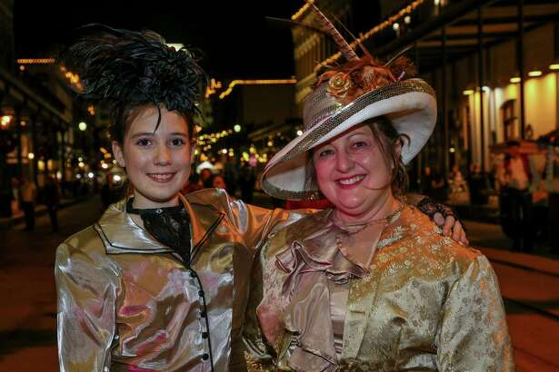 People attend the first day of the Dickens on The Strand Festival Friday, Dec. 6, 2019, in Galveston, Texas. The festival transforms the island's historic Strand into the Victorian London of Charles Dickens.