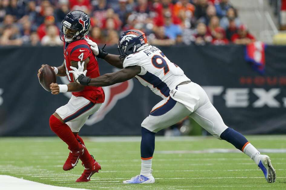 Denver Broncos linebacker Jeremiah Attaochu (97) forces Houston Texans quarterback Deshaun Watson (4) out of bounds during the first quarter of an NFL game at NRG Stadium Sunday, Dec. 8, 2019, in Houston. The Broncos won 38-24.