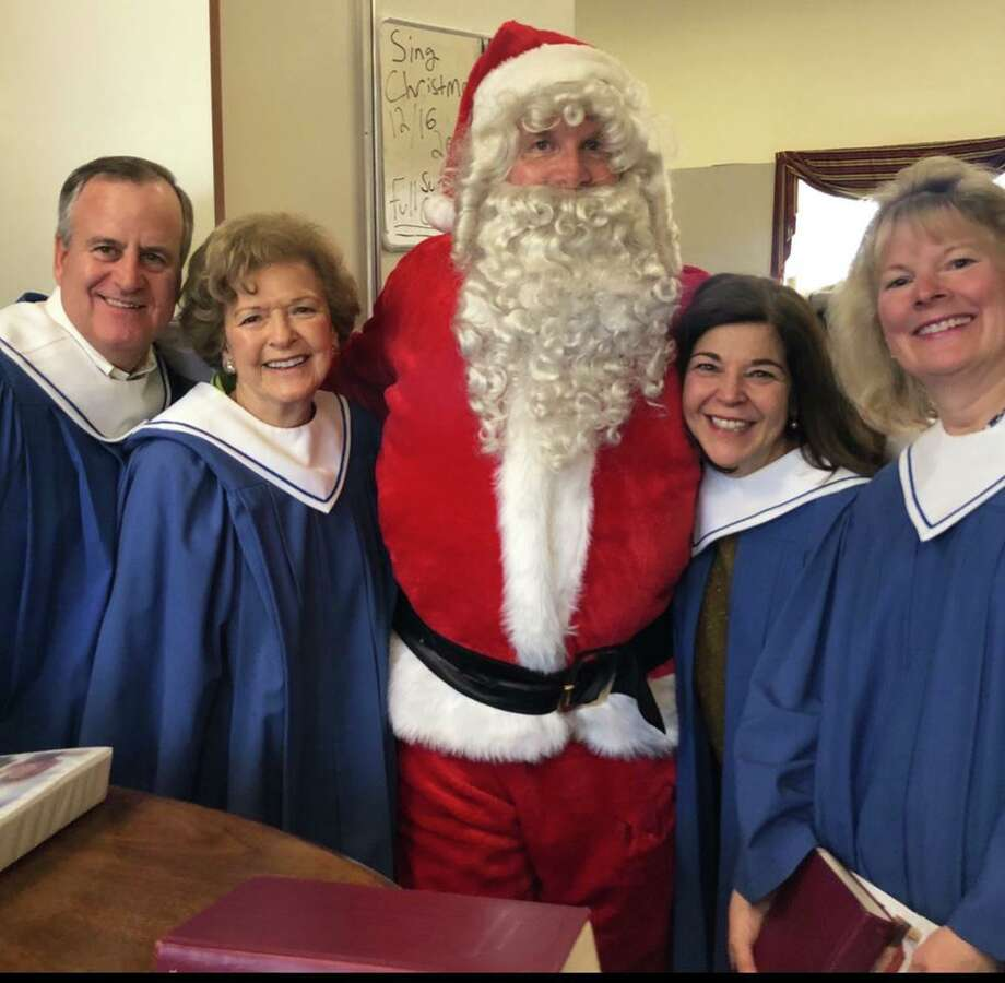 Our Lady of Fatima choir members, from left, Chris Switzer, MaryAnn Bozzuti, Janice Dehn and Lissa Seeberger join Kris Kringle in anticipation of the choir's annual Advent concert on Dec. 15. Photo: Contributed Photo / Our Lady Of Fatima Church / Wilton Bulletin Contributed