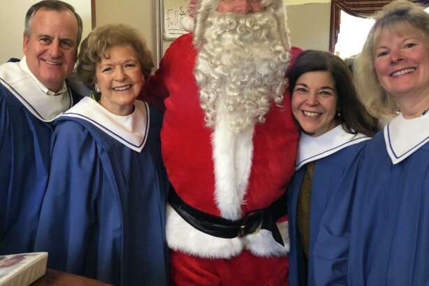 Our Lady of Fatima choir members, from left, Chris Switzer, MaryAnn Bozzuti, Janice Dehn and Lissa Seeberger join Kris Kringle in anticipation of the choir's annual Advent concert on Dec. 15.