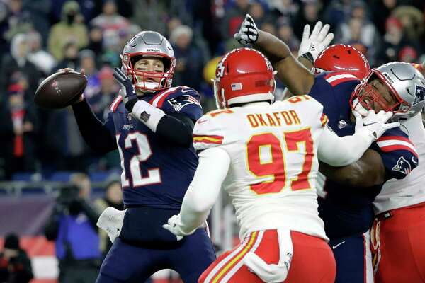 New England Patriots quarterback Tom Brady (12) passes under pressure from Kansas City Chiefs defensive end Alex Okafor (97) in the first half of an NFL football game, Sunday, Dec. 8, 2019, in Foxborough, Mass.