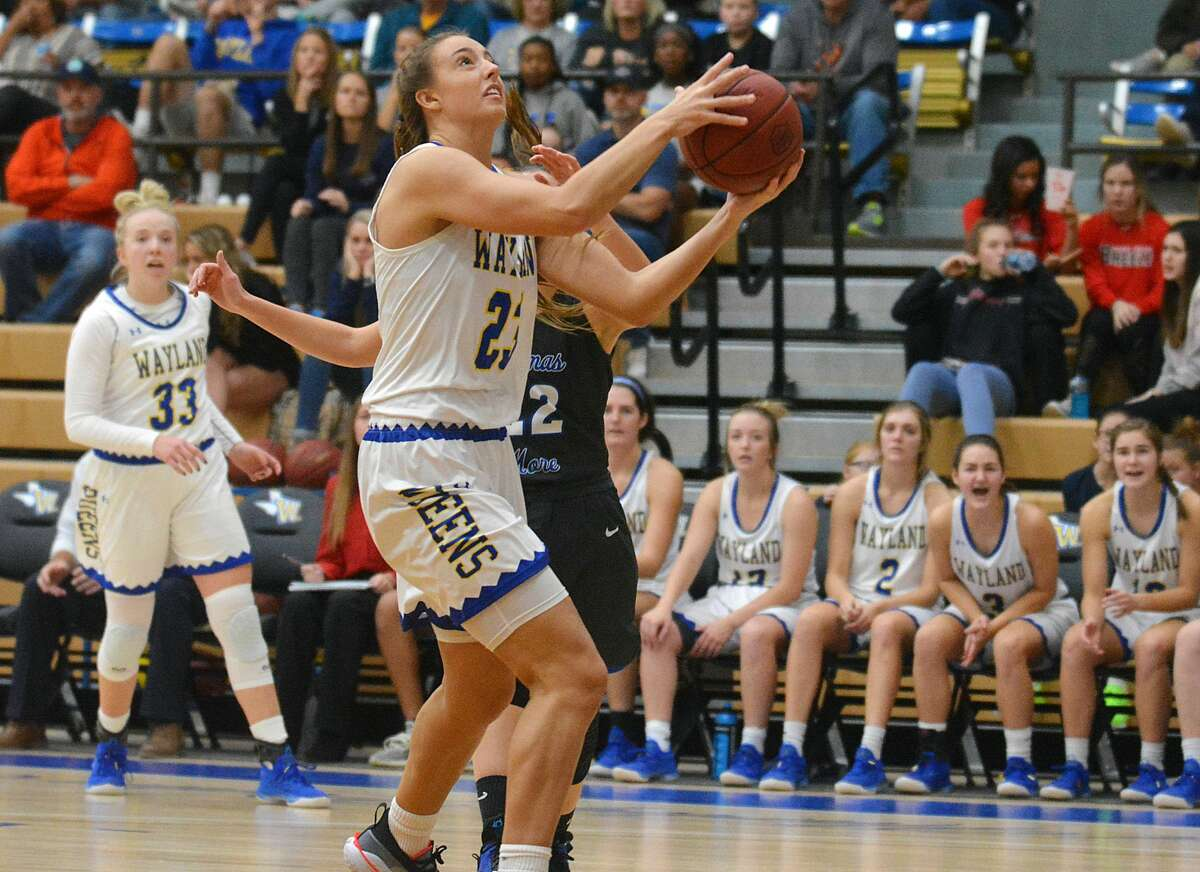 Wayland Baptist's Kambrey Blakey gets the shot up in front of Thomas More defender Briana McNutt during their NAIA women's basketball game on Saturday in the Hutcherson Center. Blakey had seven rebounds in the 92-78 win for the #6 Flying Queens over the #20 Saints.