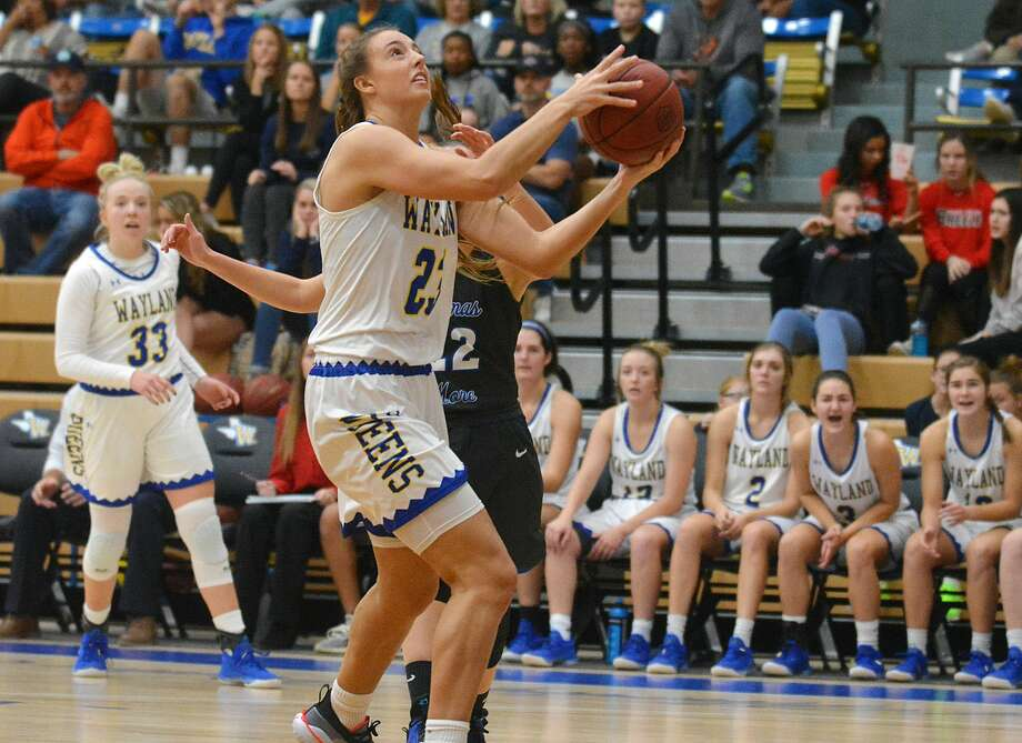 Wayland Baptist's Kambrey Blakey gets the shot up in front of Thomas More defender Briana McNutt during their NAIA women's basketball game on Saturday in the Hutcherson Center. Blakey had seven rebounds in the 92-78 win for the #6 Flying Queens over the #20 Saints. Photo: Nathan Giese/Planview Herald