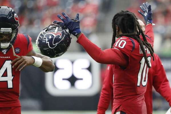 Houston Texans wide receiver DeAndre Hopkins (10) reacts with quarterback Deshaun Watson (4) as they walked back to the locker room at halftime of an NFL football game at NRG Stadium, Sunday, Dec. 8, 2019, in Houston.