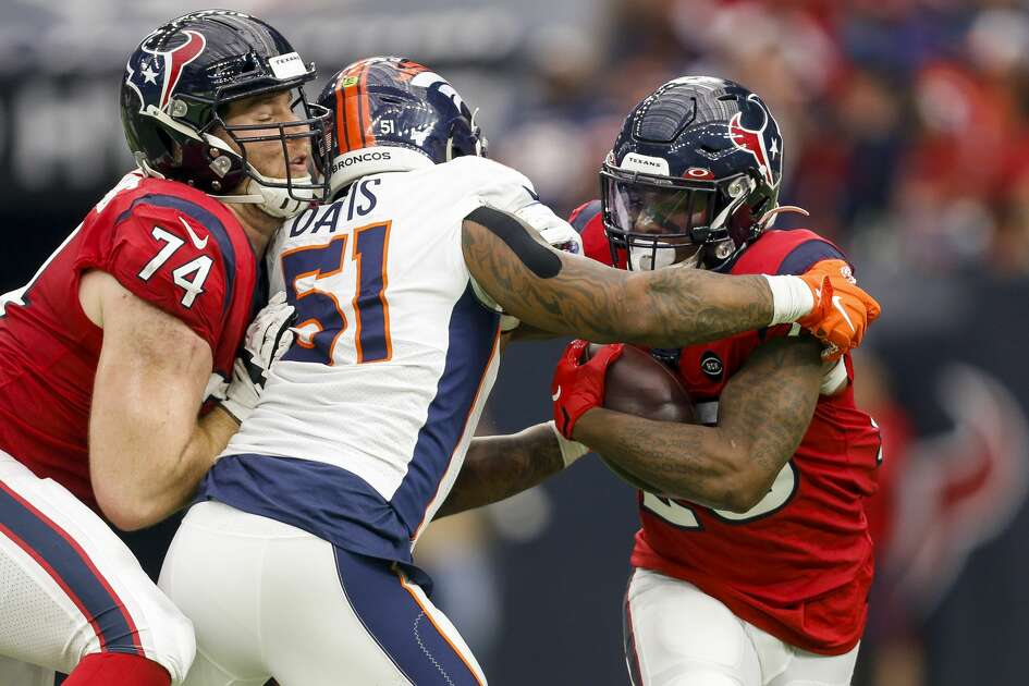 Denver Broncos inside linebacker Todd Davis (51) tackles Houston Texans running back Duke Johnson (25) during the fourth quarter of an NFL game at NRG Stadium Sunday, Dec. 8, 2019, in Houston. The Broncos won 38-24.