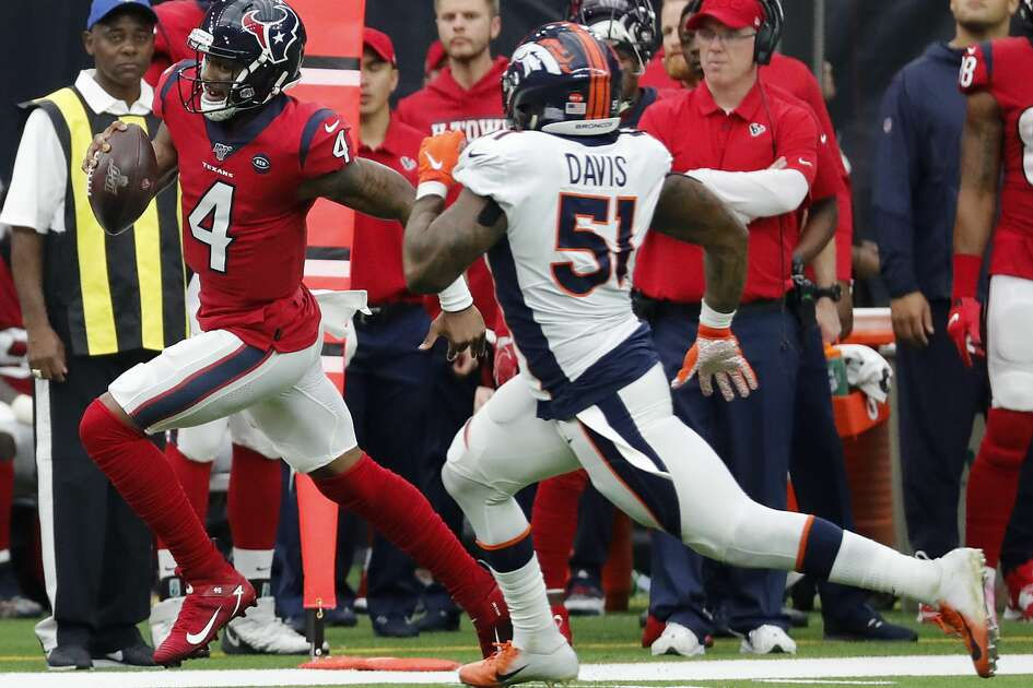 Houston Texans quarterback Deshaun Watson (4) is chased down by Denver Broncos inside linebacker Todd Davis (51) as he races down the sidelines for a first down during the third quarter of an NFL football game at NRG Stadium on Sunday, Dec. 8, 2019, in Houston.