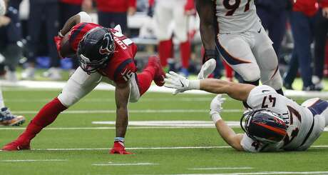 Houston Texans wide receiver Keke Coutee (16) is tripped up by Denver Broncos inside linebacker Josey Jewell (47) during the fourth quarter of an NFL football game at NRG Stadium on Sunday, Dec. 8, 2019, in Houston.