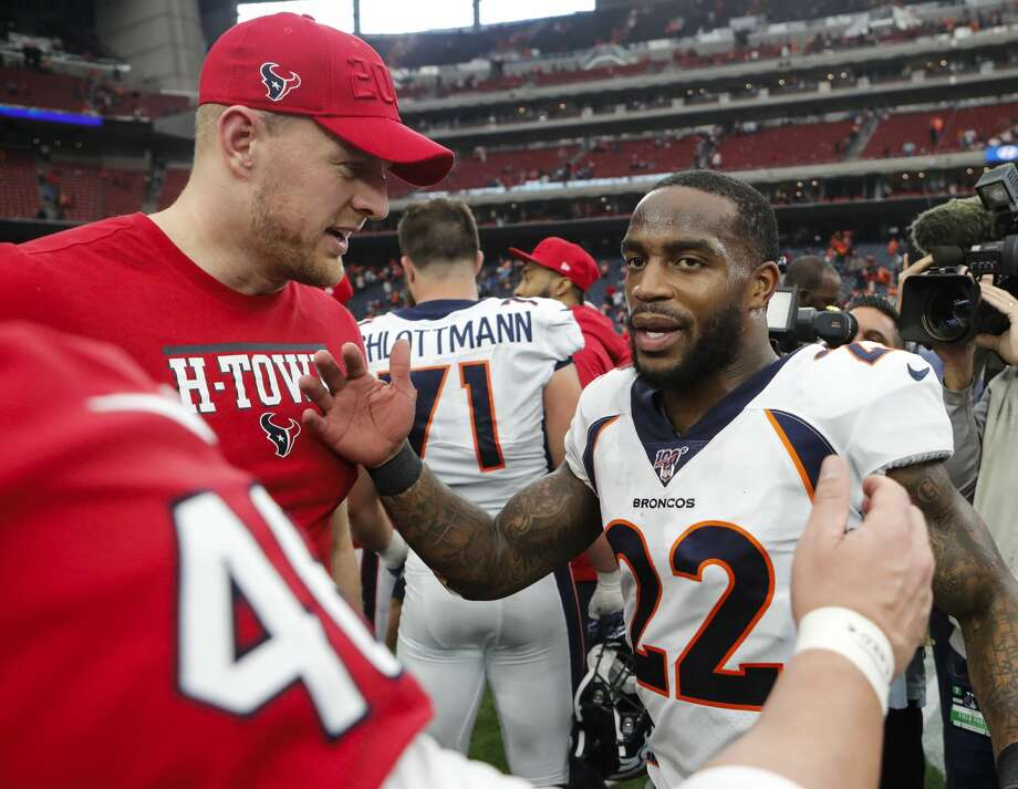 Denver Broncos and former Houston Texans strong safety Kareem Jackson (22) shakes hands with Houston Texans defensive end J.J. Watt long snapper Jon Weeks after an NFL football game at NRG Stadium on Sunday, Dec. 8, 2019, in Houston. Photo: Brett Coomer/Staff Photographer