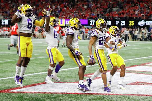 After thrashing Georgia in the SEC title game, LSU vaulted Ohio State to take the top spot in the College Football Playoff rankings.