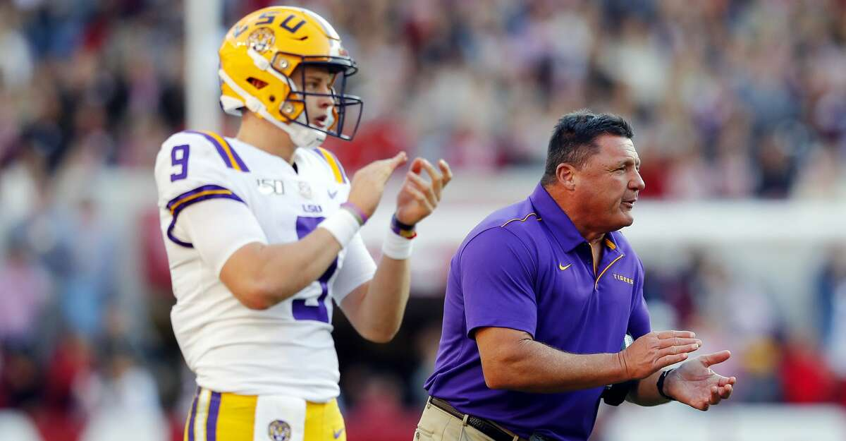 TUSCALOOSA, ALABAMA - NOVEMBER 09: Joe Burrow #9 of the LSU Tigers and head coach Ed Orgeron react during the first half against the Alabama Crimson Tide in the game at Bryant-Denny Stadium on November 09, 2019 in Tuscaloosa, Alabama. (Photo by Kevin C. Cox/Getty Images)
