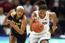 Connecticut's Megan Walker takes off with a steal from Notre Dame's Katlyn Gilbert, left, in the first half of an NCAA women's basketball game on Sunday, Dec. 8, 2019, in Storrs, Conn.
