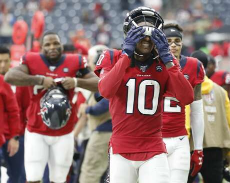 Houston Texans wide receiver DeAndre Hopkins (10) reacts as he walked back to the locker room after the Texans loss to the Denver Broncos after an NFL football game at NRG Stadium, Sunday, Dec. 8, 2019, in Houston.