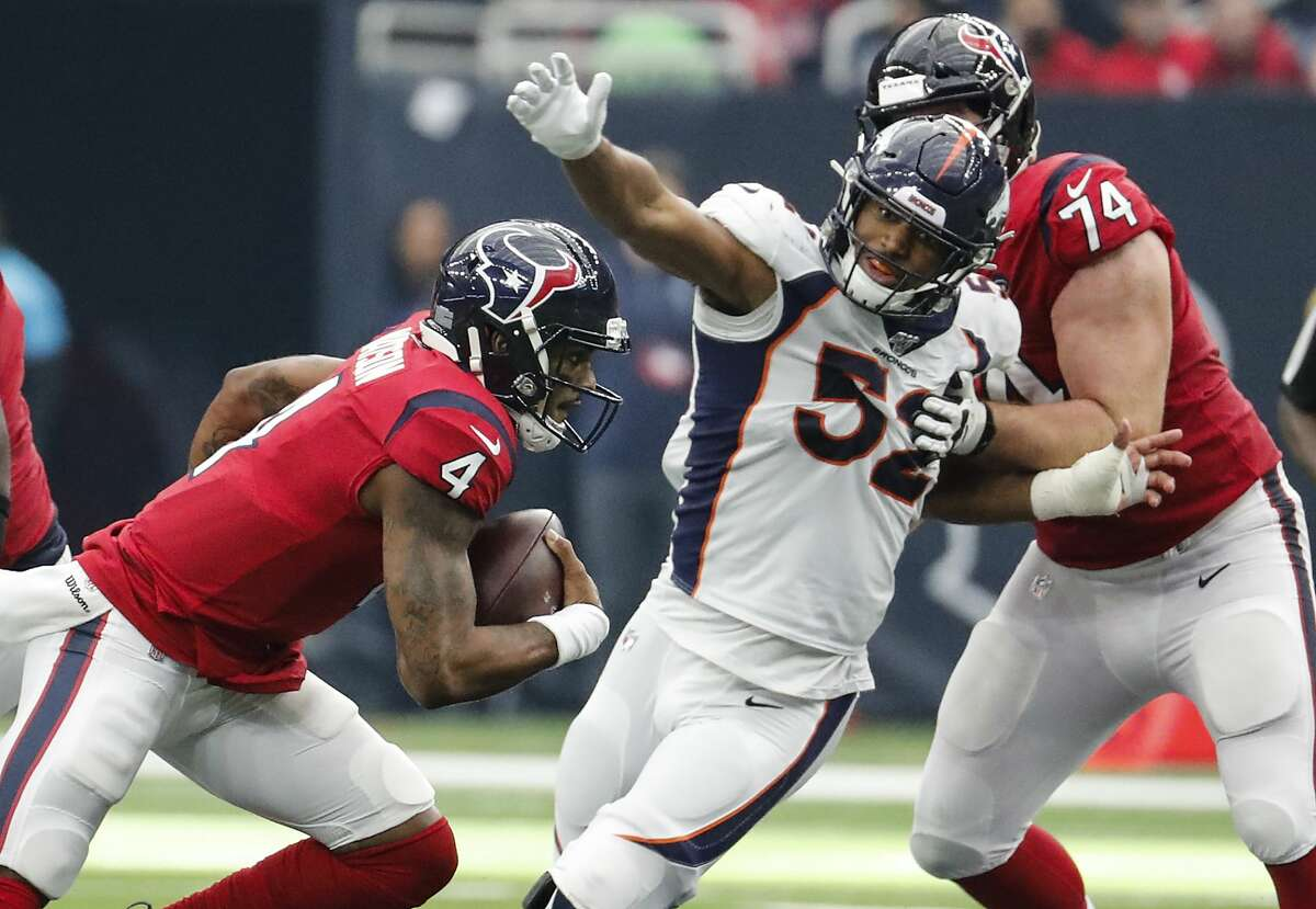 Houston Texans quarterback Deshaun Watson (4) is chased out of the pocket by Denver Broncos linebacker Justin Hollins (52) during the fourth quarter of an NFL football game at NRG Stadium on Sunday, Dec. 8, 2019, in Houston.